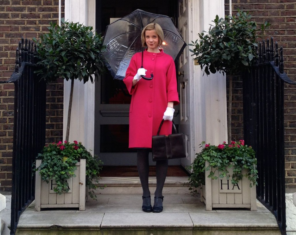 Lucy Worsley standing on the steps of Hardy Amies, the Queen's designer, on Savile Row.
