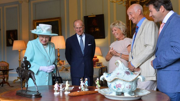 The Queen and the Duke of Edinburgh with the Antiques Roadshow team at Hillsborough Castle, June 2014.