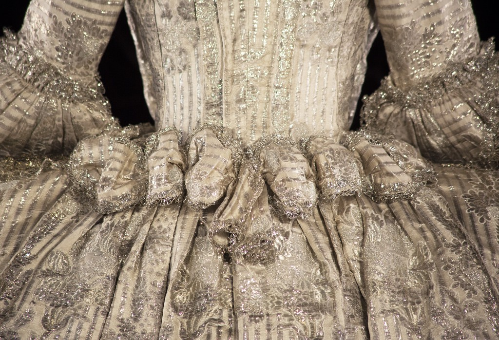 Back detail of The Rockingham Mantua, made of ivory coloured silk and silver brocade, 1760. © Historic Royal Palaces