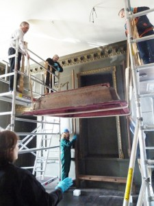 Conservators lowering the tester during deinstallation of the throne canopy