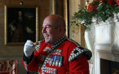 The Bugler of Hillsborough Castle enjoys a slice of Twelfth Cake.