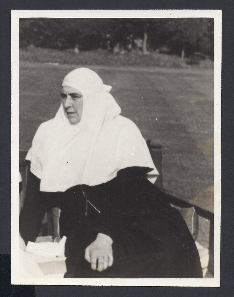 Mother Martha seated in the garden at Wilderness House. © Historic Royal Palaces Collection.