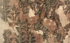 The design shows trees, acorns and a bird with a long tail