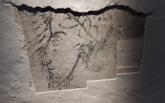 The head is gazing to his/her right which indicates that the subsequent plaster layers hide a larger composition. However, we may not be able to uncover it entirely as the marbling scheme is also of historical interest.