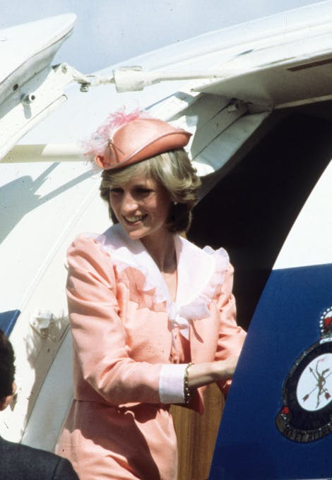 Diana wearing her going away outfit with the long-sleeved jacket for her first official overseas tour to Australia in 1982. Anwar Hussein/Getty Images